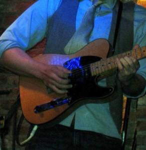 guitarist playing the blues shuffle