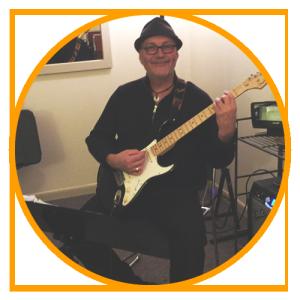 man taking guitar lessons