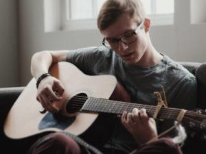 teenage boy taking guitar lessons