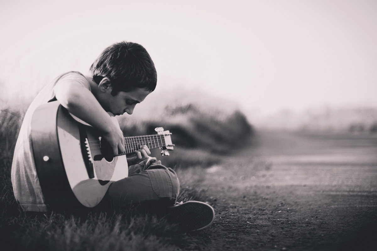 how learning to play the guitar benefits your children. Black Bedroom Furniture Sets. Home Design Ideas