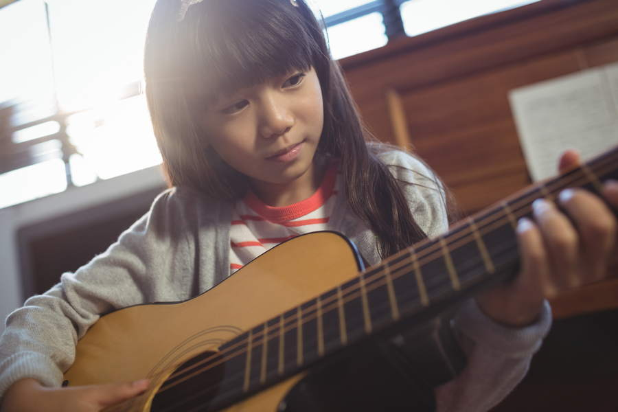 The Benefits of Guitar Lessons for Kids