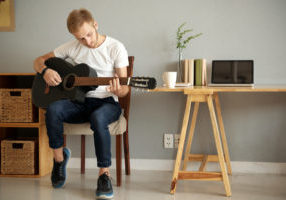 How Long Does It Take for Adults to Learn Guitar